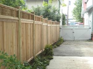 Wood fence along a driveway