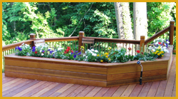 Brighten up your deck this spring with bright flowers and plants that your guests will find pleasant.